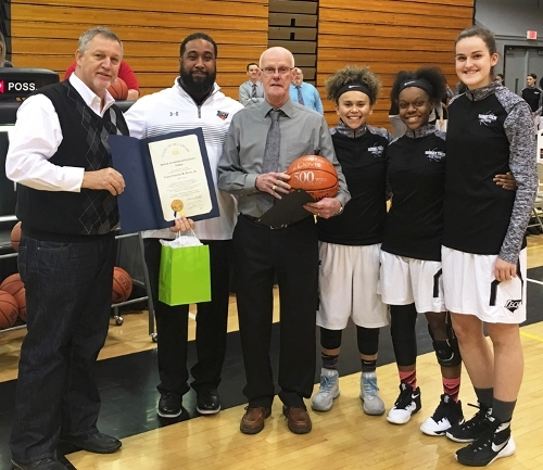 Sussex Tech Coach Chester Davis celebrates his 500th career victory