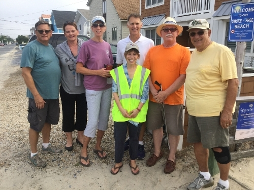 Local volunteers participate in the 30th Annual Delaware Coastal Cleanup includes
